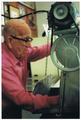 Ernest working the machine