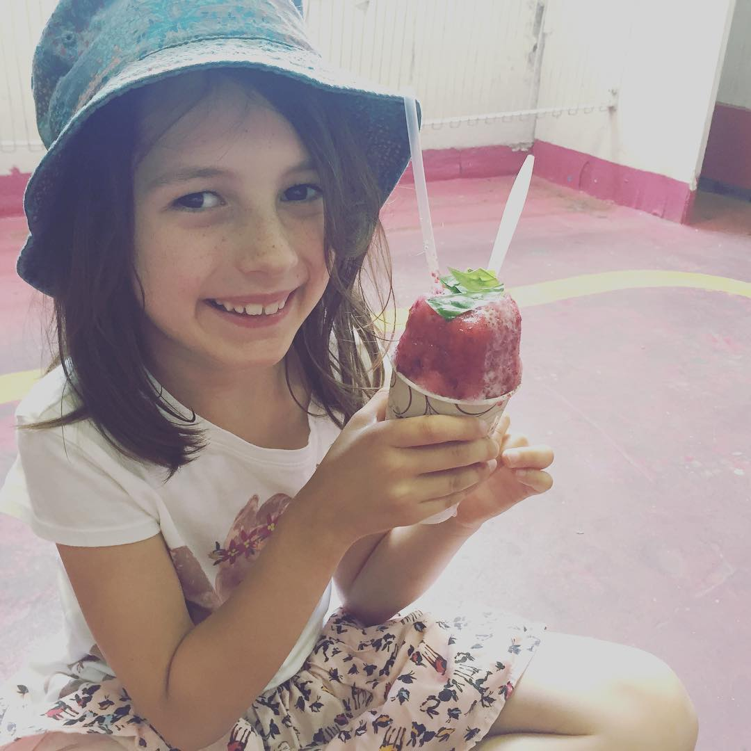 It's Special Flavor Friday! We've got blackberry syrup all weekend (until supplies run out!) Try it like little Ms. Avery here, topped with canned cream and fresh basil from @paradigm_gardens. 🌿🍇🍧☺️ #FarmToSnoball #ThereAreNoShortcutsToQuality #AirConditionYourTummy