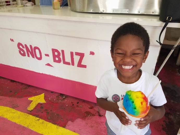 Micro-super-Sno-Bliz fan Andrew has found the end of the rainbow, and discovered it's not filled with gold, it's filled with smiles. 😍🍧🌈 (photo via Facebook / Natasha Ben-Kamara)