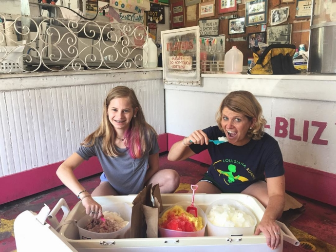 Jordan & Stephanie just had to take a couple of bites from their 3-gallon buckets! Who could resist 3 gallons of satsuma or chocolate or cream of ice cream?! We make 1 & 3 gallon buckets to order (the 3 gallon size with just a little tiny bit of advance notice!) and can provide you with cups, spoons, and straws – even a little dry ice for your cooler, too, to help get the Party-Bliz started!