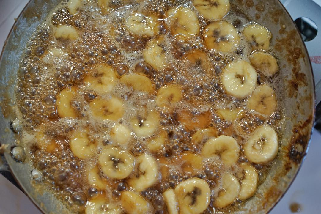 Cooking up bananas for Bananas Foster stuffed snoballs now till this Sunday 1-7 pm! We only make it once a month